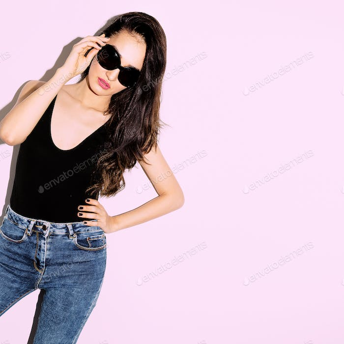 Brunette Girl in black body and trendy sunglasses.  Summer look