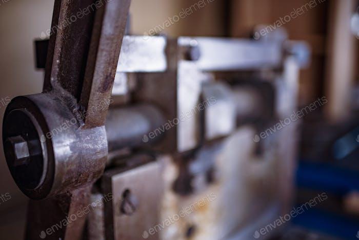 Guillotine machine close-up rusty metal massive parts