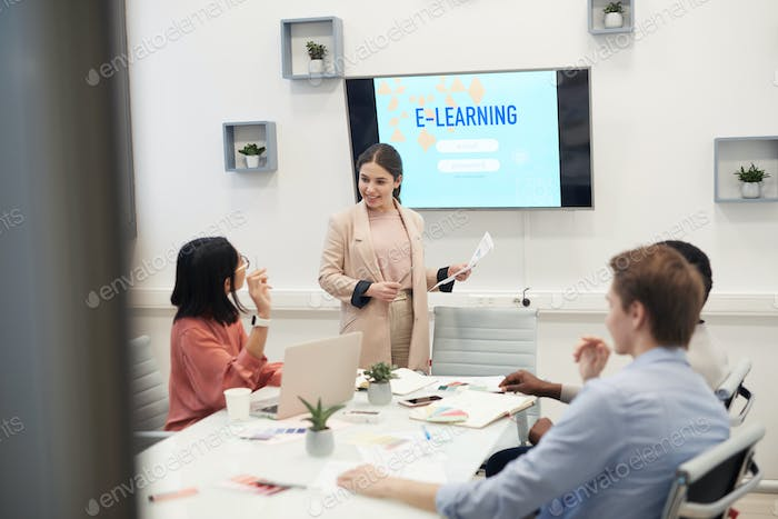 Young Businesswoman Giving Presentation in Meeting