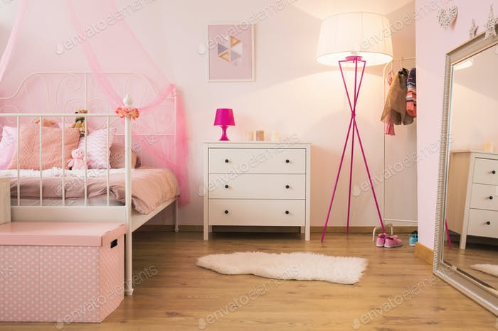 Pink child bedroom with lamp