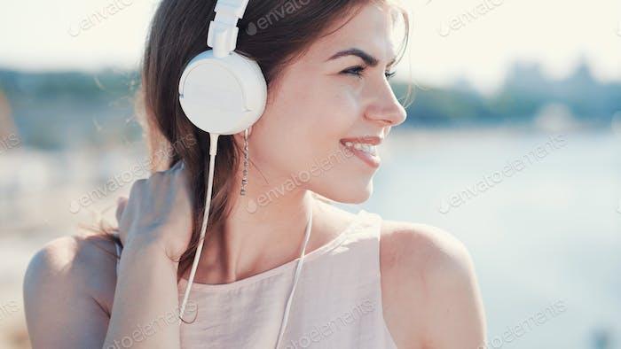 Smiling girl listen to music