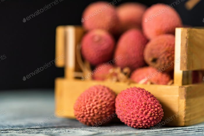 Lychee fruit in wooden box close