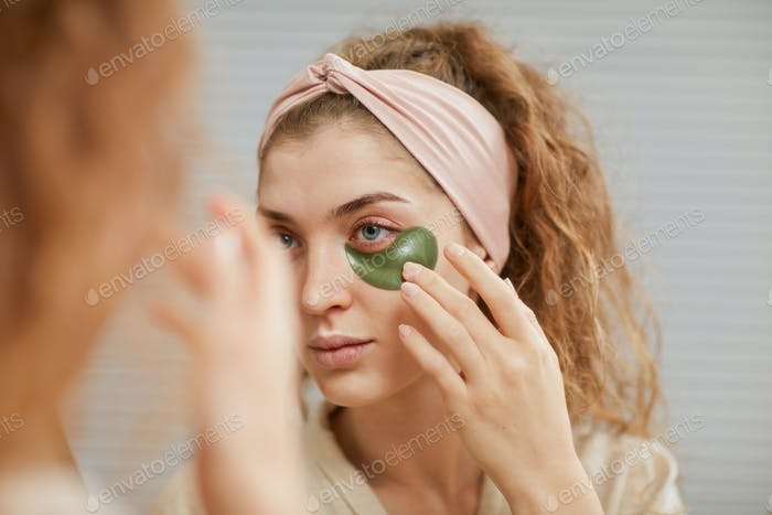 Woman applying patches