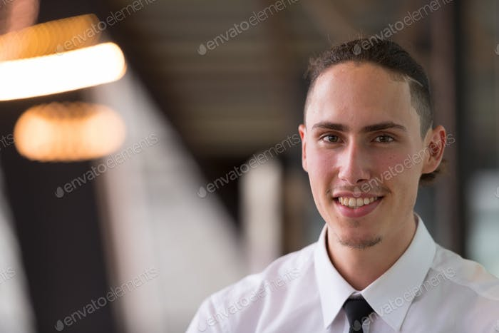 Portrait Of Young Handsome Businessman Smiling