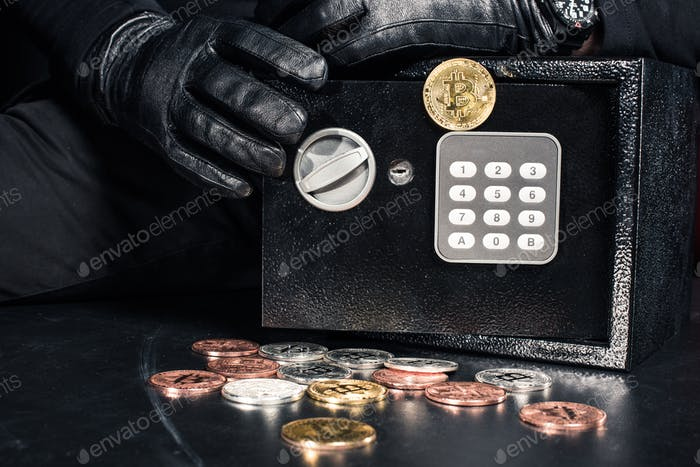 Close-up view of man opening safe with bitcoin cryptocurrency