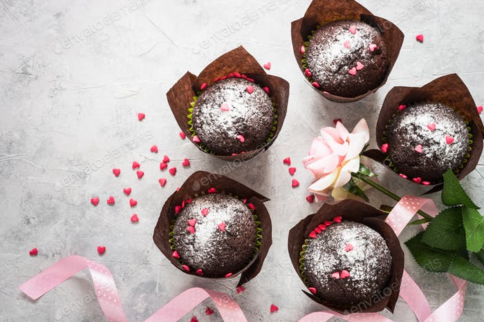 Valentines day background. Chocolate cupcake and flower.