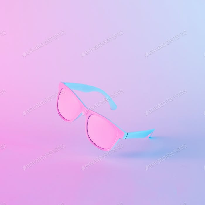 Sunglasses in vibrant bold gradient purple and blue holographic colors.