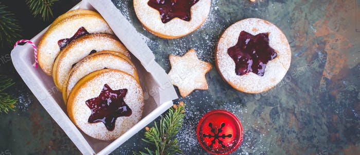 Christmas or New Year homemade sweet present. Traditional Austrian christmas cookies Linzer biscuits