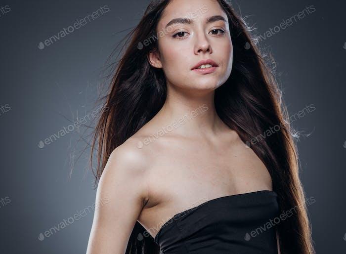 Beautiful woman smooth long hair brunette natural make up beautiful female portrait dark background