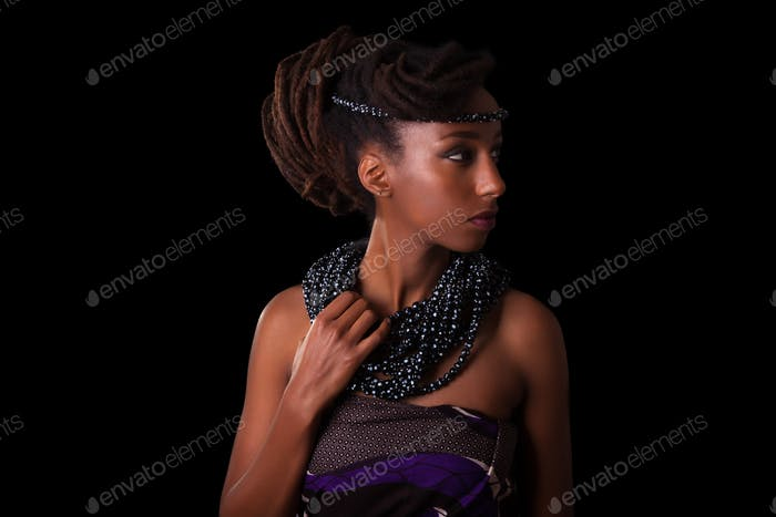 Young beautiful african woman wearing  traditional jewelry, Isol