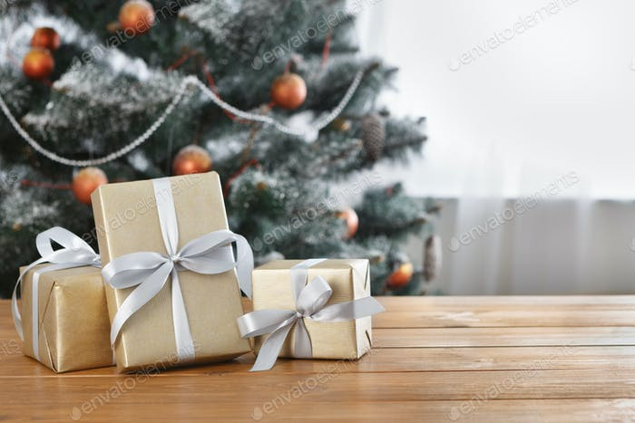 Christmas present on decorated room background, holiday concept