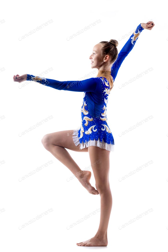 Happy acrobat girl dancing