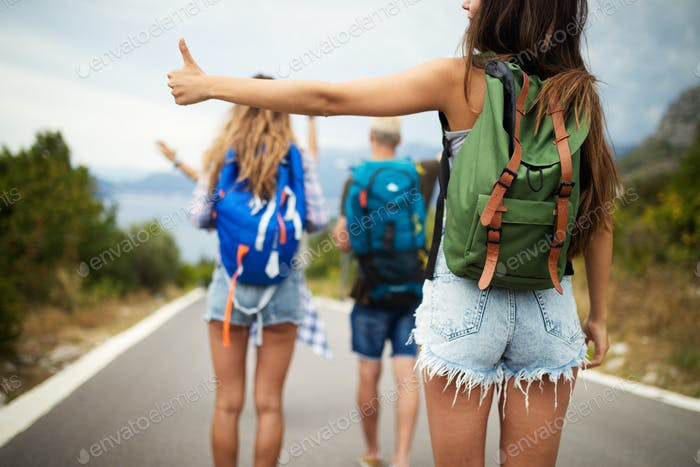 Group of friends traveling together and having fun