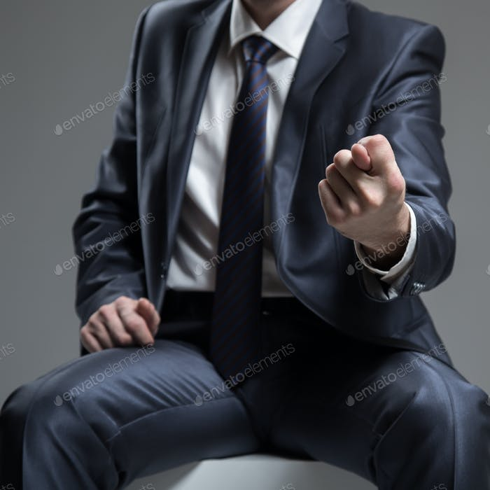 Businessman in Blue Suit Show Fig Sign. Concept About Angry