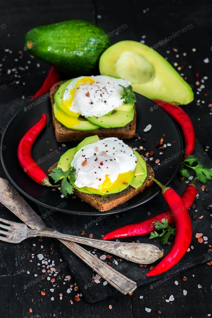 Toasts with avocado and poached eggs