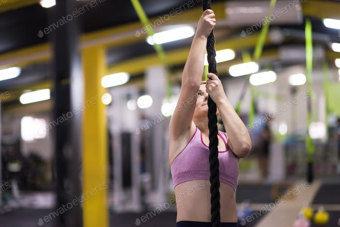 woman doing rope climbing