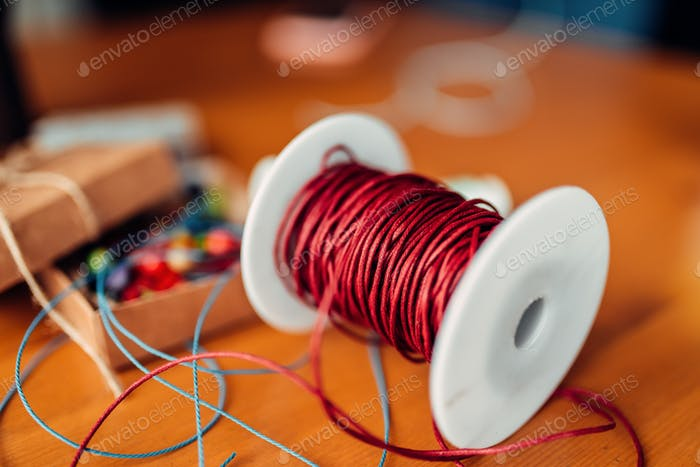 Needlework, coil with red decorative rope, closeup