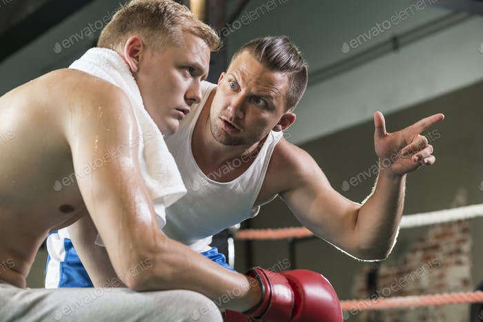Trainer motivating boxer before fight