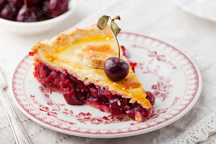 Slice of cherry pie with ice cream