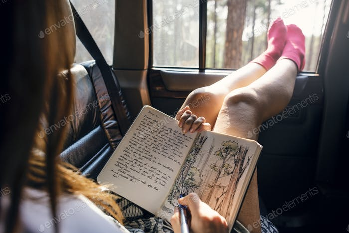 Girl Drawing Pad Road Trip Concept