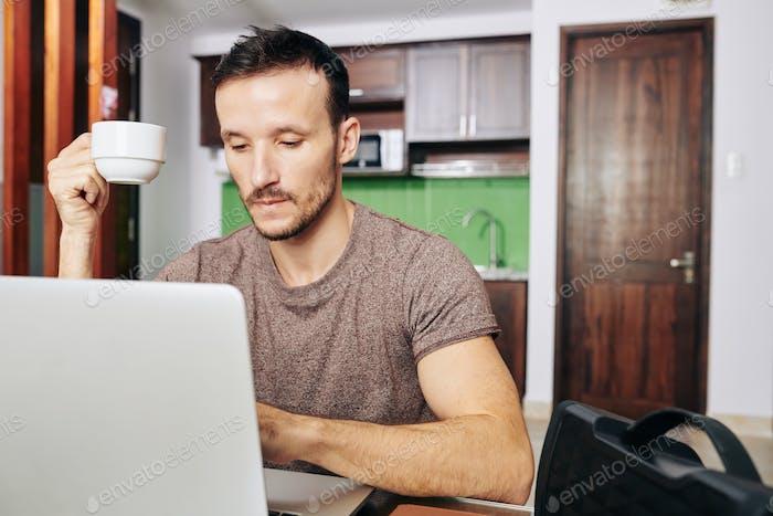 Programmer drinking coffee