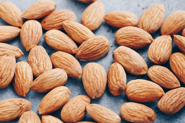 Fresh almond nuts. Food background, macro photography.