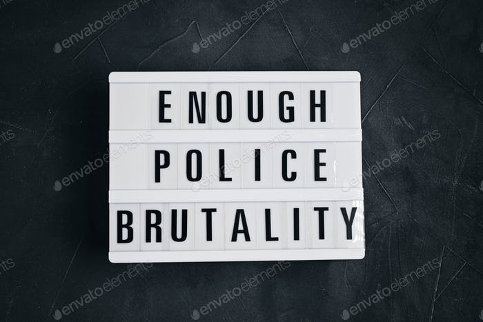 Enough Police brutality text on light box on dark background