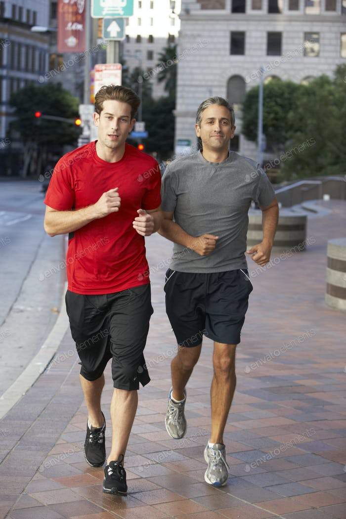Two Men Running On Urban Street