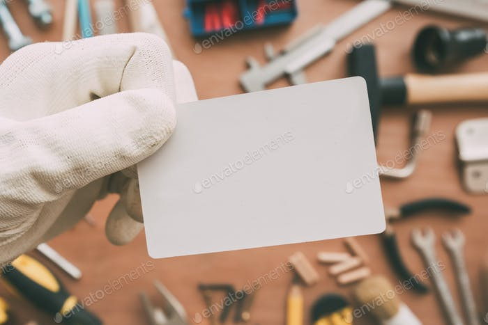 Maintenance worker blank business card as copy space