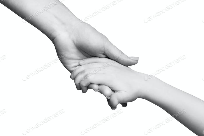 Mother caring about child holding his small hand on white