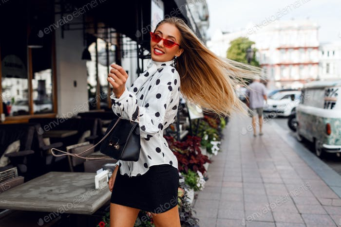 Lovable confident blond woman with long hairstyle