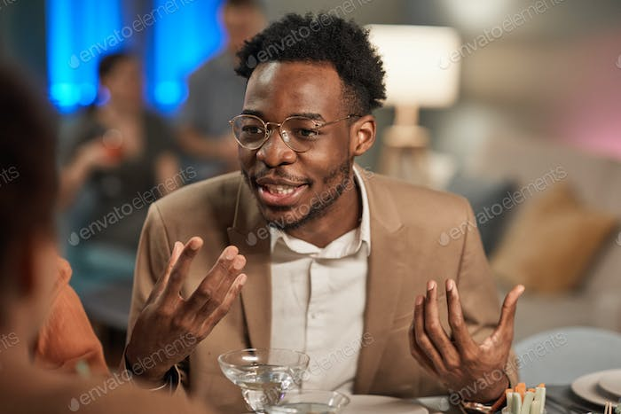 Man Telling Story at Dinner Table
