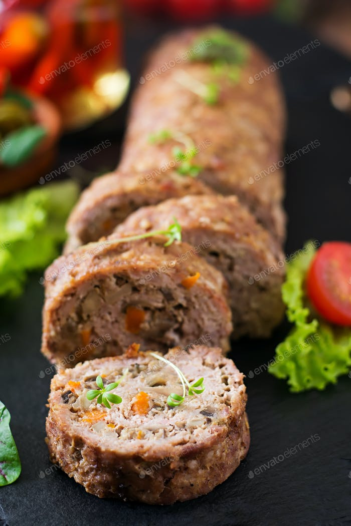 Minced meat loaf roll with mushrooms and carrots.