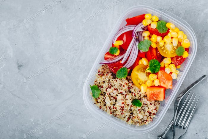 Healthy vegan meal prep containers with quinoa and fresh vegetables