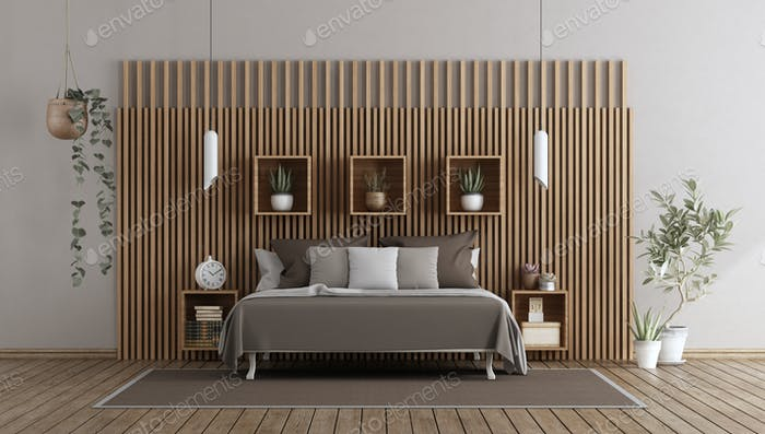 Master bedroom with bed against wooden paneling