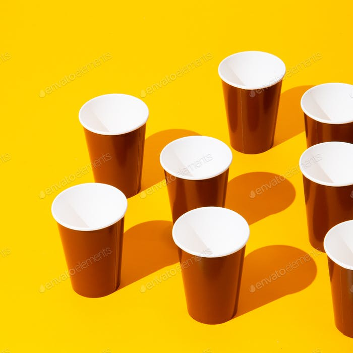 Coffee plastic cups in isometric on yellow background. Minimal. Still life art