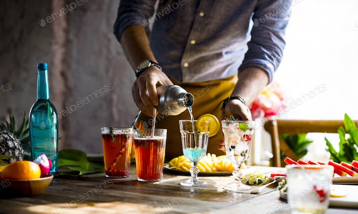 Bartender guy working prepare cocktail skills
