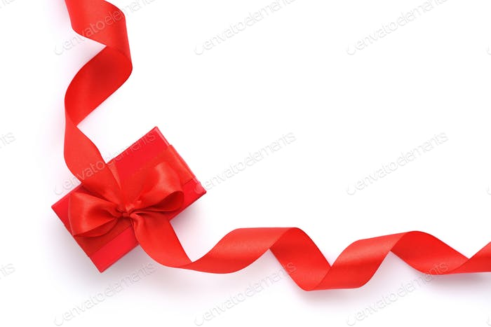Red gift box with red ribbon on white background. Top view
