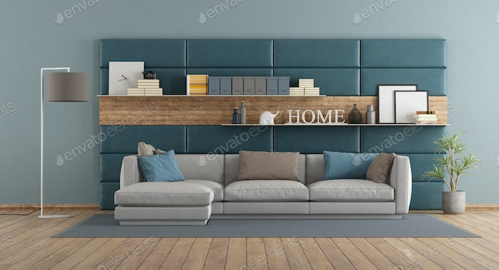 Modern living room with sofa against paneling