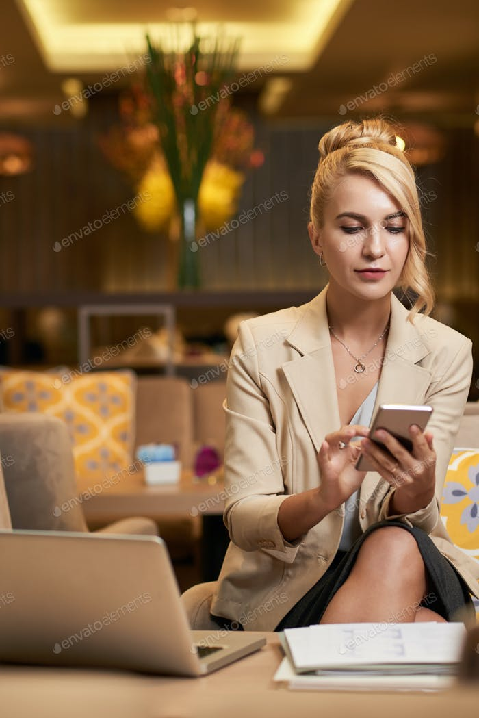 Business woman checking phone