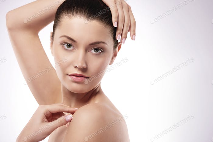 Beautiful natural woman with hands raised