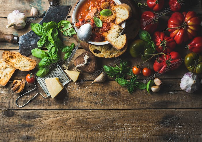 Italian roasted tomato and garlic soup in bowl, copy space