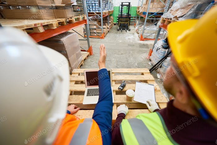 Construction Workers in Warehouse