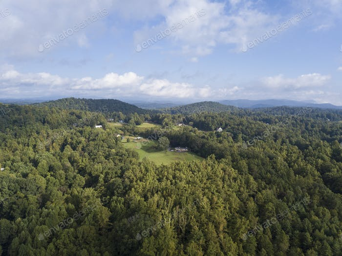 Aerial view of forest and houses in the Blue Ridge Mountains of western North Carolina.
