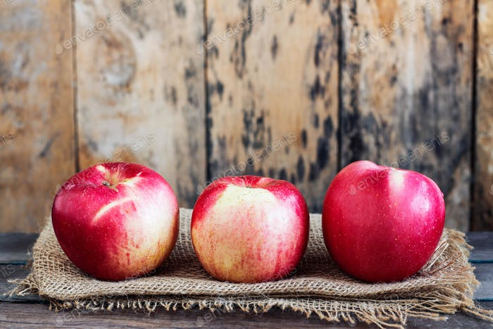 Apples fresh on the old wooden
