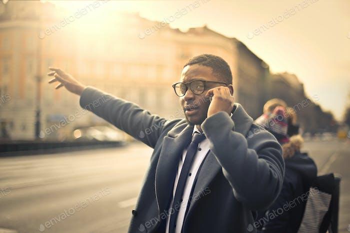 Businessman calling a cab