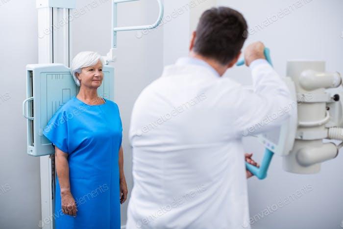 Senior woman undergoing an x-ray test