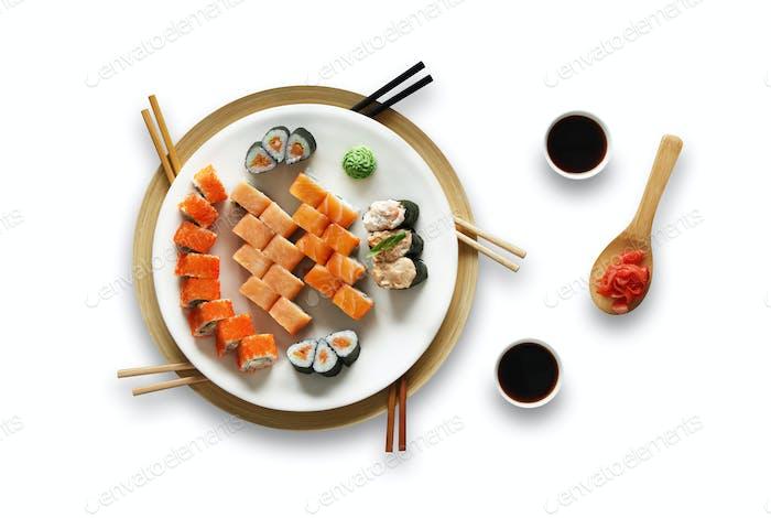 Set of unagi sushi and rolls isolated at white.