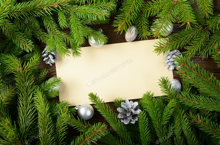 Thumbnail for Flat lay mockup of holiday greeting card made of brown craft paper fir twigs cones
