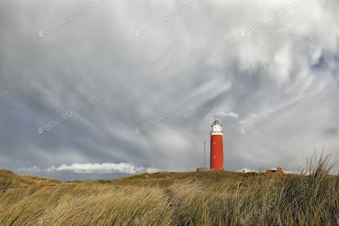 dramatic sky over ed lighthouse on hill